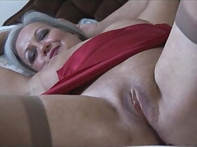 granny porn - Attractive bust granny in slip and stockings strips